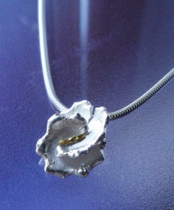 silver and fine gold welded pendant