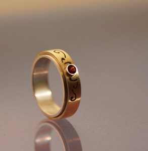 Ruby ring with gold and silver band