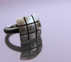 Silver ring with oxidized band and ice-finish
