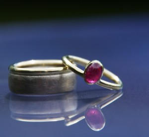 white and yellow gold wedding band with combination ruby ring