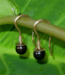 gold earrings with black pearls
