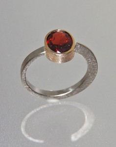garnet ring with white and yellow gold