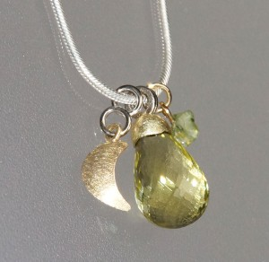 charm pendants in white and yellow gold with lemon citrine and peridot