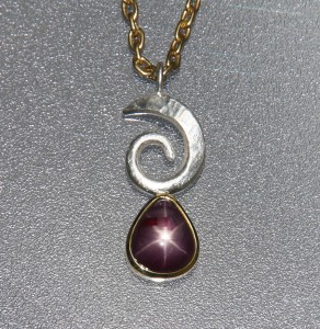 yellow gold and silver pendant with star ruby