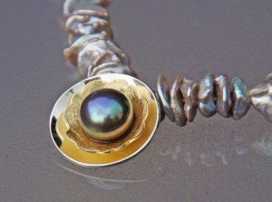 gold and silver pendant with dark freshwater bouton pearl