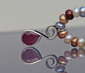 freshwater pearl necklace with ruby in a silver setting
