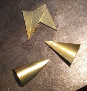 I'm making yellow gold pearls earrings. The first step is sawing four identical triangles from a flat sheet of gold.