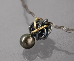 tahiti pearl pendant with gold and oxidized silver
