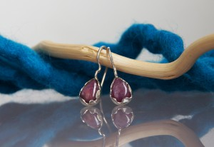 silver ruby earrings with a wavy setting